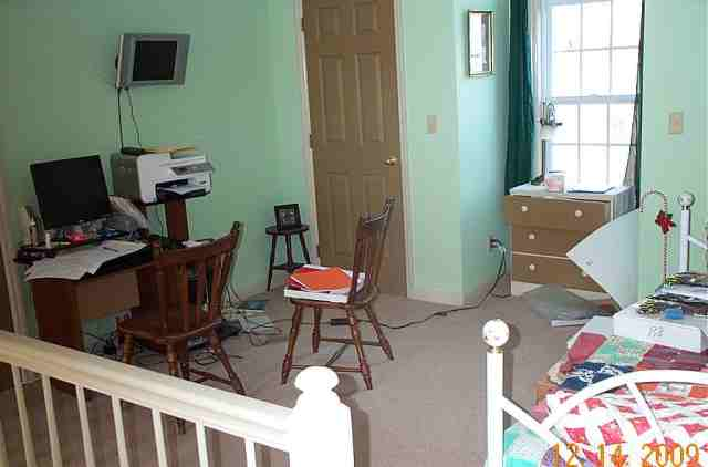 The loft area doubles as my office and the spare bedroom. The trundle bed opens to two single beds.