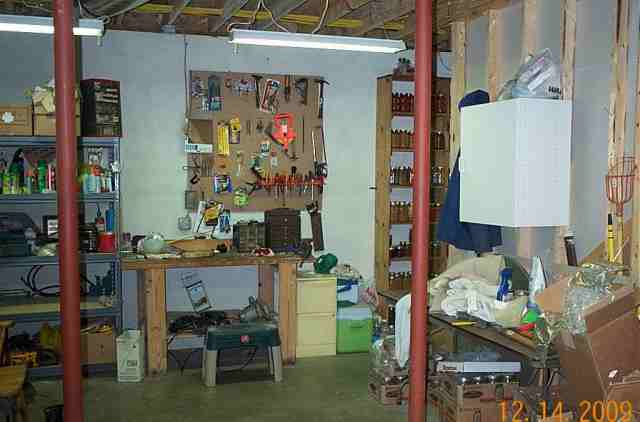 Here is his workbench with shelves to the left.